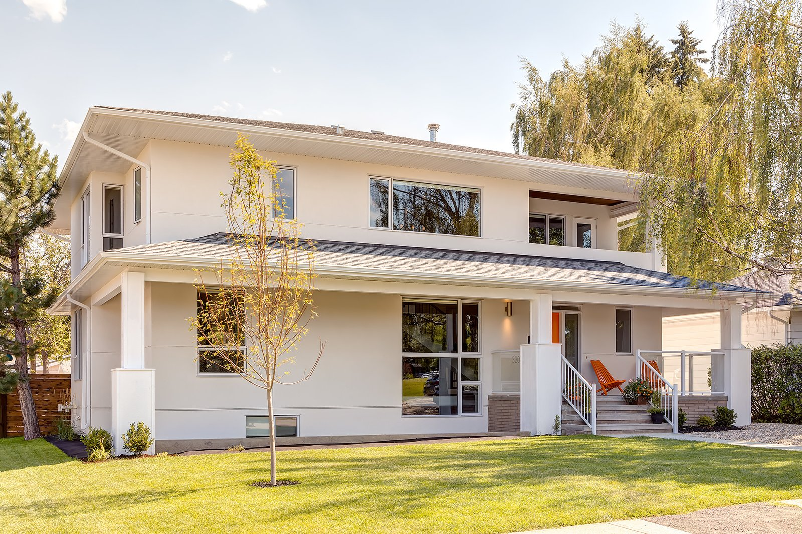 """""""The design needed to allow each group enough privacy and independence so that the home would meet their needs regardless of how many people were under its roof at a given time,"""" Lewis said. Architectural white stucco and tongue and grove cedar comprise the siding, and Cambridge architectural asphalt shingles from IKO cover the roof.  A Calgary Home Makes Space for Three Generations by Kelly Dawson"""
