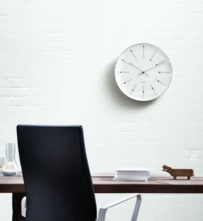 The Bankers Clock, originally conceived for the Danish National Bank in 1971 by master architect and designer Arne Jacobsen, is here, faithfully reproduced by Rosendahl Copenhagen from Jacobsen's original drawings. Cased in aluminum, and featuring precise Japanese Quartz Movement, this breathtakingly simple piece will bring timeless appeal to any space.