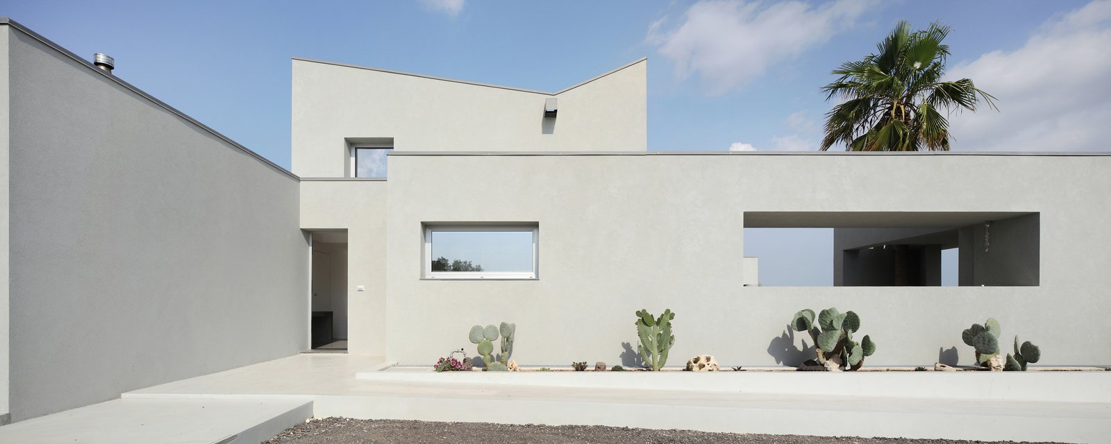 """The architect calls the house a """"contemporary interpretation of the traditional Hyblaean villa."""" Both the promenade and groves of native olive trees are typical features of that style.  A Home That Dramatically Replicates a Starry Sky in Its Living Room by Caroline Wallis"""