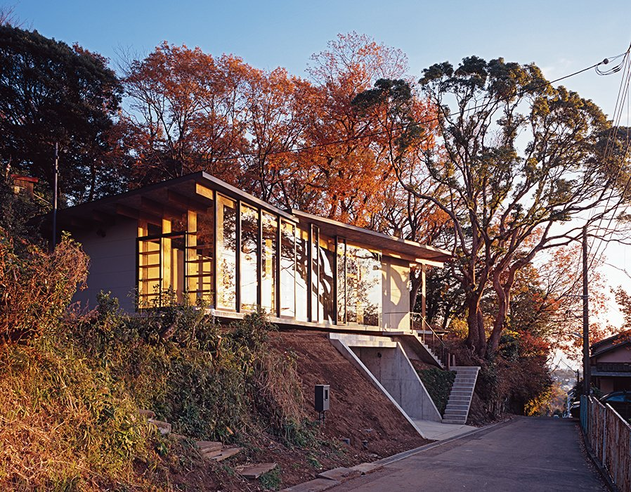 Exterior, House Building Type, Wood Siding Material, and Concrete Siding Material The architects designed the steel-frame doors and windows, which were fabricated by Takeuchi Kozai.  Photo 7 of 8 in Japanese Home Among the Trees Uses Bookshelves and Glass for Walls
