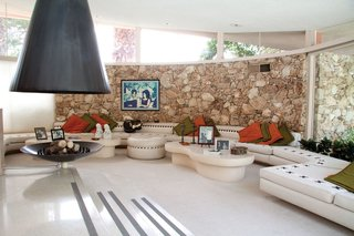 Developer: Robert Alexander  Location: Palm Springs, CA  Price: $9.5 million  Built by Palm Springs mega-developer Robert Alexander for his family in 1960, this midcentury mod pad replete with conversation pit and floating fireplace was the location for Elvis's honeymoon with Priscilla back in 1966.