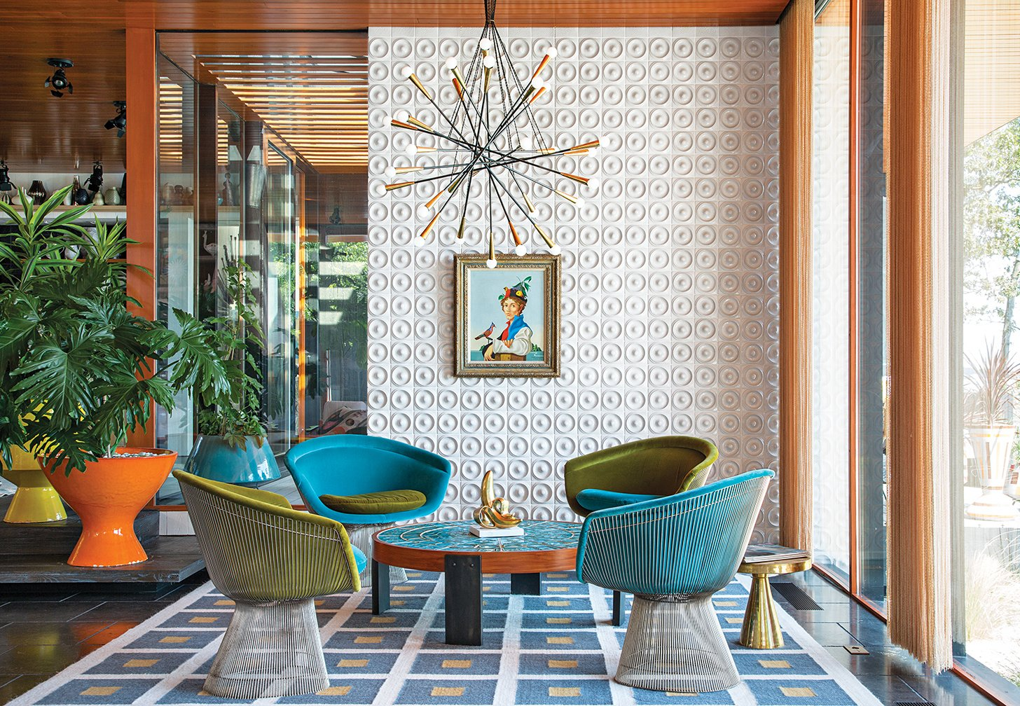 """There's no right answer except to play and experiment,"" says interior designer Jonathan Adler in regards to the Shelter Island getaway he shares with his husband, fellow design expert Simon Doonan. Custom ceramic wall tiles, a few plants, and a self-made rug, stool, and coffee table all add to the home's inimitable decor. Tagged: Living Room, Chair, and Pendant Lighting.  Best Photos from Spaces Transformed by Interior Plants"