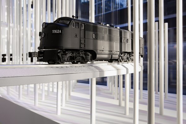 Model trains travel through the store, weaving in and out of the rods.
