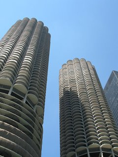 Often likened to corncobs or honeycombs, each Marina City tower has 19 levels of open-air garage parking beneath 40 levels of residences. Their strident pose beside the river, atop a podium of shops, restaurants, services, and a marina, was part of their financer's effort to build a showstopper that would keep 900 families in the city at the height of urban flight.