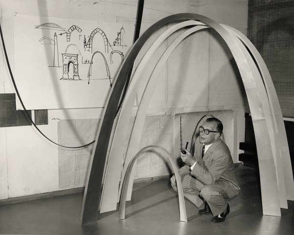 Finnish-American architect Eero Saarinen designed the Gateway Arch monument, completed in St. Louis in 1965 (it opened to the public in 1967). The world's largest arch, the iconic, 632-foot tall structure was built as a monument to westward expansion in the United States. Here, he's shown alongside models of the arch.  Credit: Yale University Library, Manuscripts and Archives; © St. Louis Post-Dispatch
