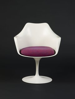 """Saarinen designed his famous Tulip armchair as part of the Pedestal collection for Knoll in 1956 (manufacturing began the following year). With its minimal base and narrow, simple stem, the clean-lined design aimed to provide a solution to clunkier designs of, in the designer's own words, """"ugly, confusing, unrestful world."""""""