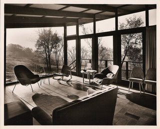 We spy a handful of iconic Saarinen chairs in the interior of architect Robert Elkington's self-designed midcentury residence—long since potentially threatened by demolition and disrepair.  Image courtesy of Kyrle Boldt III.