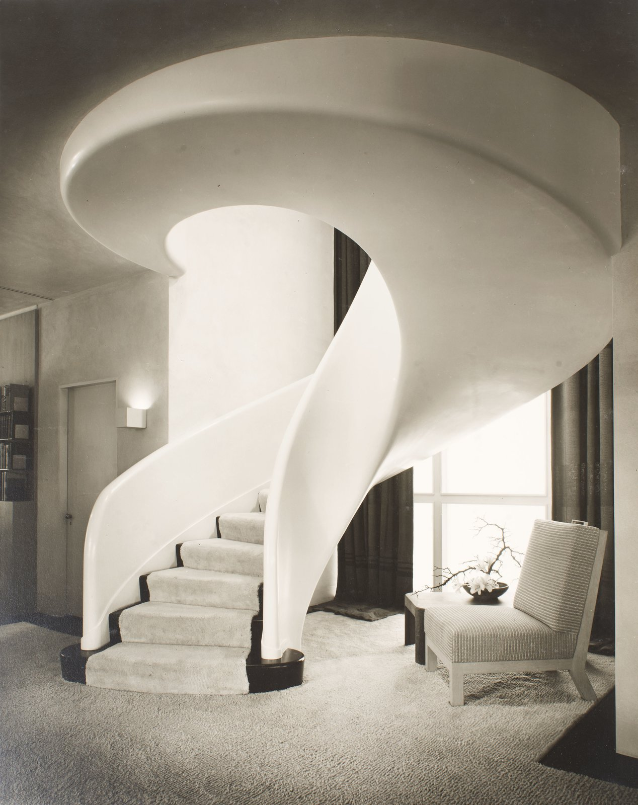 A swirling, sculptural staircase serves as the centerpiece in this 1940 residence designed by Samuel A. Marx for Morton D. May in Ladue, Missouri.   Credit: © Chicago History Museum, Hedrich-Blessing, photographer  Timeless Iconic Design from St. Louis Celebrates 50 Years of the Gateway Arch by Eero Saarinen
