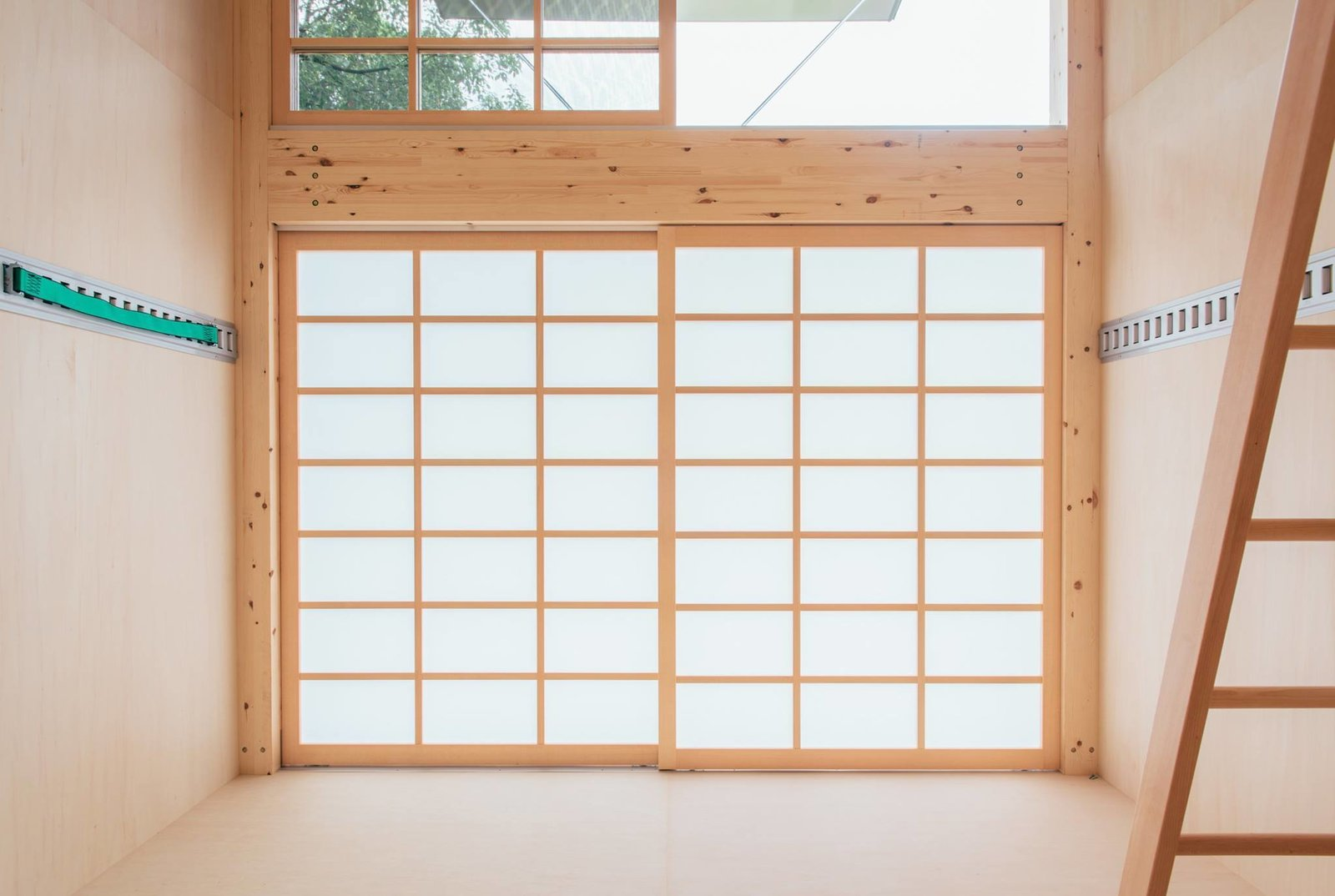A semi-transparent, shoji-style sliding door allows filtered sunlight into the space, while also maintaining privacy.  Muji Hut Launches With 3 New Tiny Prefab Homes by Aileen Kwun