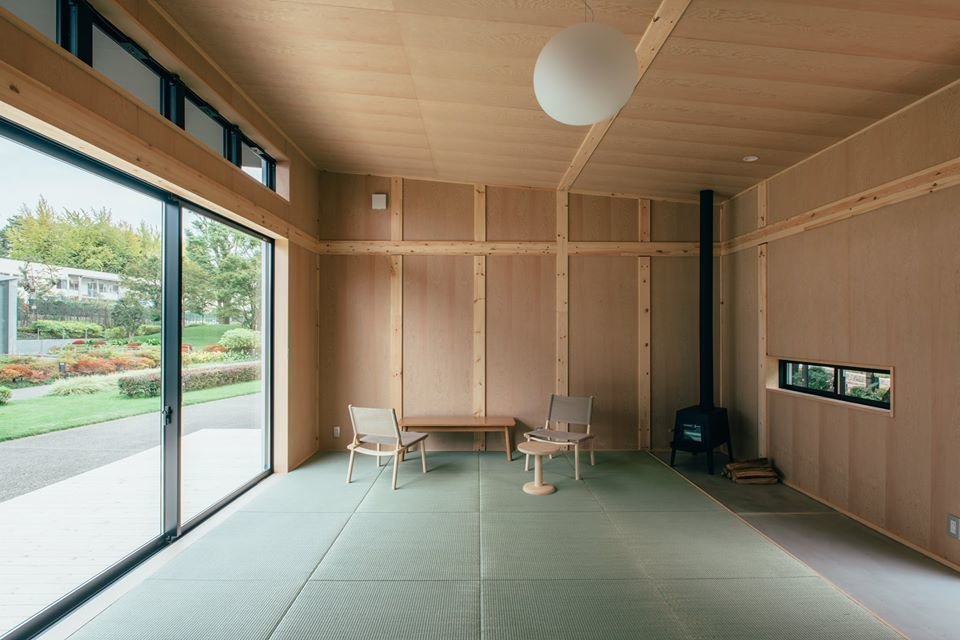 While still simple and modest, it includes a few more amenities than offered by Grcic's design, including a wood-burning stove, sliding glass doors, tatami-style flooring, and a row of clerestory windows.  Muji Hut Launches With 3 New Tiny Prefab Homes by Aileen Kwun