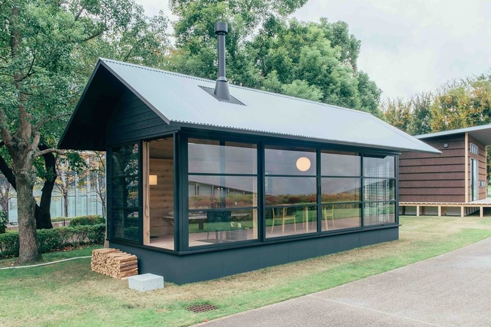 The third hut, by Muji's head design consultant and revered product designer Naoto Fukasawa, is made primarily of timber. Ideal for an outdoor retreat, it features a pitched roof and an expansive wall of glass.  Muji Hut Launches With 3 New Tiny Prefab Homes by Aileen Kwun