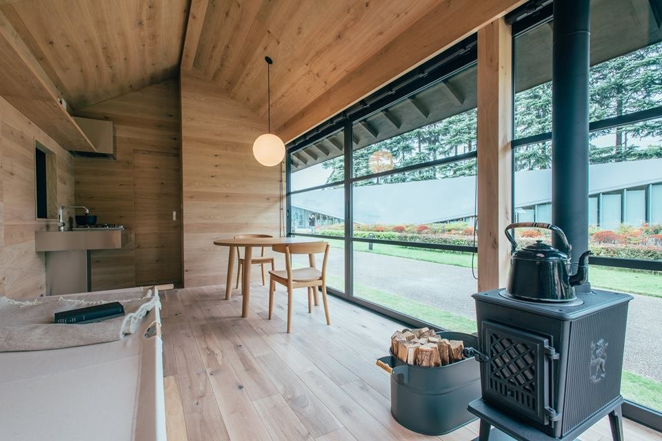 As with Morrison's Muji Hut model, it includes a wood-burning stove and small kitchenette. As suggested by the cot and spare setup, it'd make for an ideal retreat from urban living.  Muji Hut Launches With 3 New Tiny Prefab Homes by Aileen Kwun