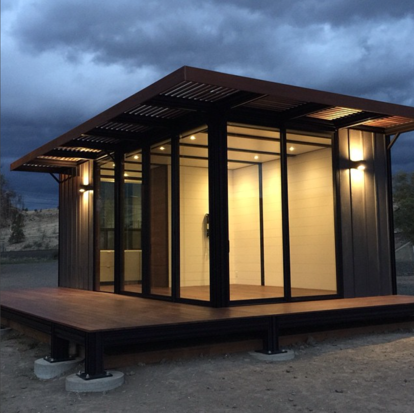 Exterior, Metal Roof Material, Wood Siding Material, Flat RoofLine, Glass Siding Material, and Prefab Building Type Starting from $65,000, the k6 model includes various add-on options, including a full kitchen and bath.  Photo 7 of 22 in Modern Modular Homes for Sale From $10K to $200K from Photo of the Week: Tiny Prefab on the Banks of the Oregon River