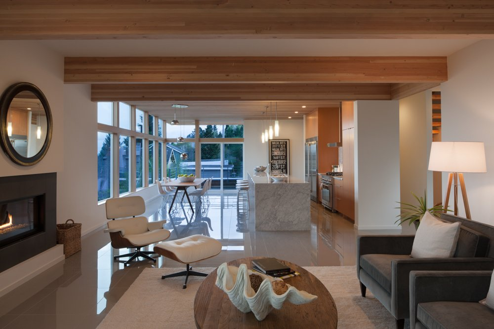 """""""The living space is defined by exposed Douglas fir beams that continue inside from [street] entrance,"""" Weber said. The floor's polished """"Light Grey"""" tiles from Olympia Tile's Unicolor Series are a muted detail.  Cedar Douglas Residence by Kelly Dawson"""
