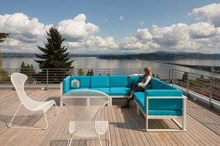 In keeping with the rest of the home, the deck was built from cedar. The tight-knot, 5/4-inch by 4-inch planks are enclosed by a steel guardrail.