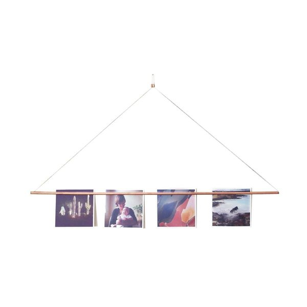 Last but not least, this Copper Photo Bar Picture Hanger uses a single nail to hold photos, print, or any graphic material. Designed by Yield Design Co. and Social Print Studio, it can be hung anywhere and - thanks to its six magnets - it won't harm your artwork.