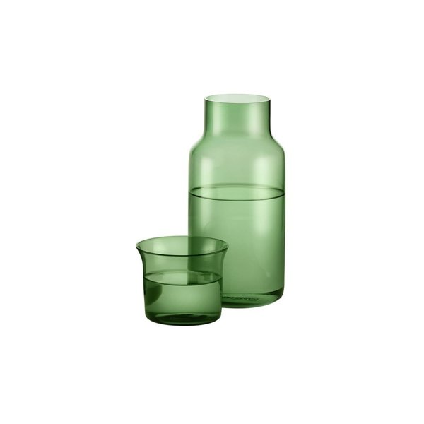 The Luxe Carafe Set includes one glass carafe and a coordinating drinking glass, meant to rest atop the carafe when not in use. The set is designed for use on a bedside table, but it can also elevate a master bathroom. Crafted from hand-blown glass, the Luxe Carafe Set is defined by its subtle curves.