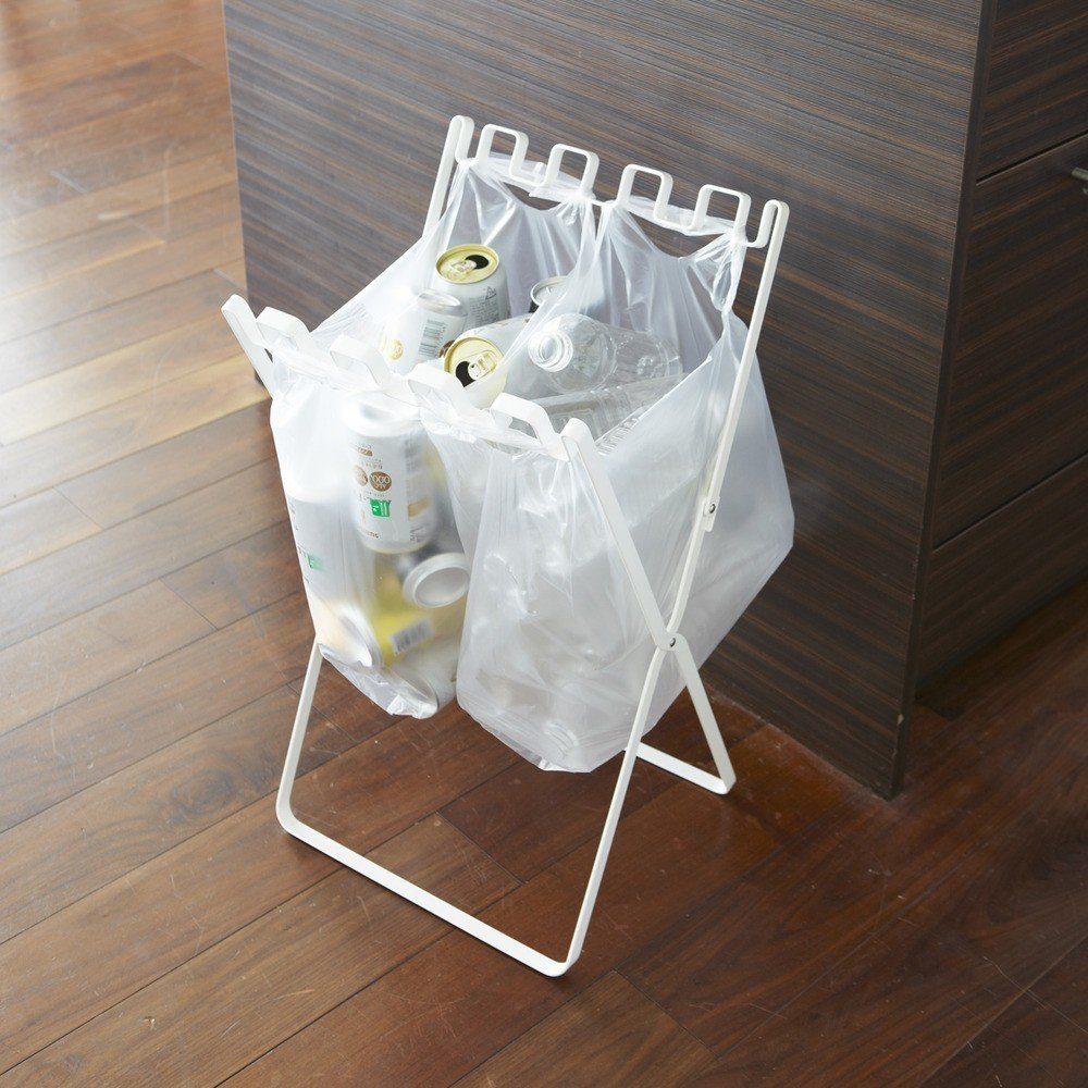 From Japanese company Yamazaki, the Recycling Bag Stand is an innovative accessory designed with urban living in mind. The simple accessory unfolds to a standing position that can hold several plastic bags—from grocery shopping, takeout, and other errands—enabling users to directly recycle plastic containers, cans, and other items into the bags.  Small Spaces from Dwell Store Editor's Picks: Shop the Special Issue
