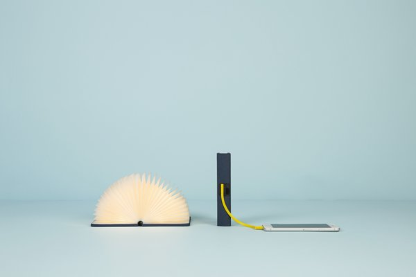 Mini Lumio+ by Max Gunawan for Lumio, $125 at hellolumio.com  An extra lightweight companion to the original Lumio, a literal book light created by architect Max Gunawan, the mini Lumio+ achieves the same spellbinding LED effect as its predecessor, while also providing a portable means to charge electronics.