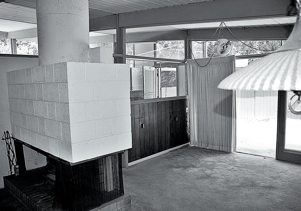 The pair worked with the existing chunky fireplace and concrete floors.  Photo 6 of 15 in L.A. Renovation Respects Midcentury Bones (While Adding Some Flair)