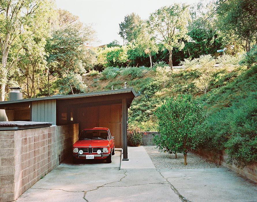 The carport leads to the entrance. Tagged: Garage.  47+ Midcentury Modern Homes Across America by Luke Hopping from L.A. Renovation Respects Midcentury Bones (While Adding Some Flair)