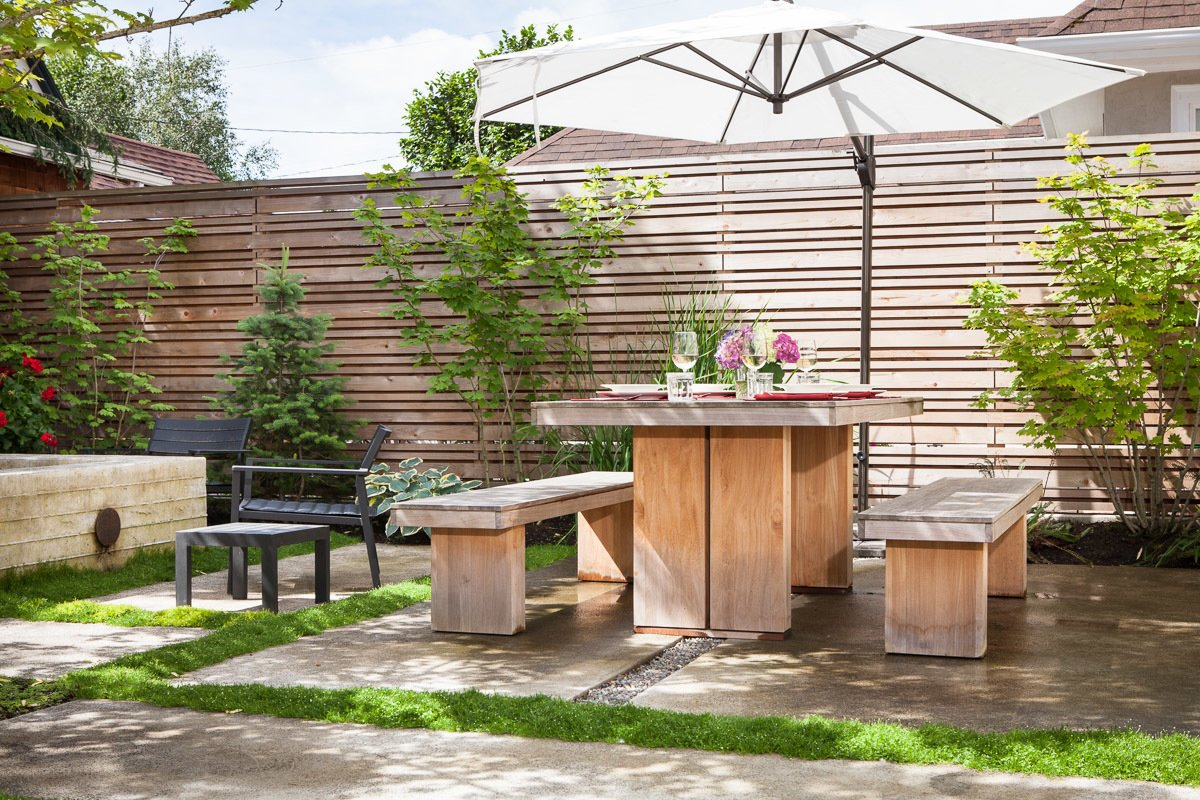 Since Portland is at roughly the same latitude as Sapporo, Japan, Howells was inspired by minimalist Japanese gardens. All of the wood used in the space, including the furniture, is designed to weather to a silver-gray shade over time.  Japanese-Inspired Backyard with a Tiny Studio in Portland by Allie Weiss