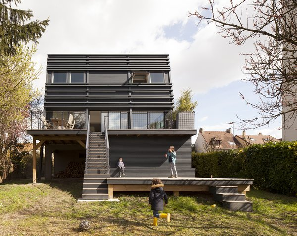 "For this next home renovation and expansion, also in a suburb of Paris, the client was a family of five seeking something ""simple, brigt and spacious,"" says Djuric. While the house sports this sleek new exterior, and larger windows to admit more sunlight, it's the interior where the transformation is most evident."