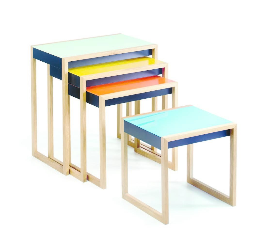 "Josef Albers's nesting tables represent one of his earliest, most functional exercises in color theory. Designed in the late 1920s while Albers was at the Bauhaus, the oak-and-glass tables are still available today.  Search ""classic danish nesting tables set"" from Awesome Modular Furniture for Customizing Your Home"