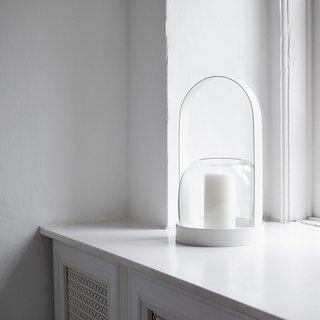 The Carrie Candle Lantern is a distinctive accessory that can be used both indoors and out. Featuring a handle and base crafted from powder-coated steel, the Carrie includes a glass vase that can be used with a tall candle, flowers, or other items that deserve showcasing.