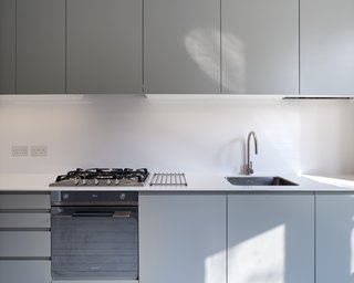 Minimalist design can sometimes be a mystery, like modern kitchen cabinets that have no visible hardware. However, a quick little push on the edge of a cabinet can reveal an interior spring mechanism that holds the doors closed.