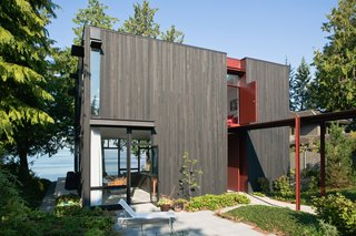 On the shores of the Puget Sound, Tom Kundig built a house that doubles as a private retreat and a place for entertaining. The two-story cedar-clad house is positioned to maximize water views and natural light, with custom hardware and steel accents designed by the architect.