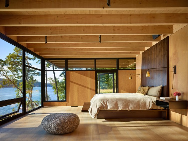 Bedroom, Bed, and Wall Lighting On San Juan island, Pole Pass is an intimate waterfront retreat built to serve as a gathering space that takes advantage of the temperate Pacific Northwest summers.  Best Photos from Discover the Work of a Leading Seattle Modernist