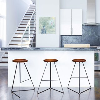 First released in 2010, the Coleman Counter Stool was awarded a Best Furniture Award from the 2015 Dwell on Design Awards. This stool has a black powder-coated base and locally sourced walnut wood seat.
