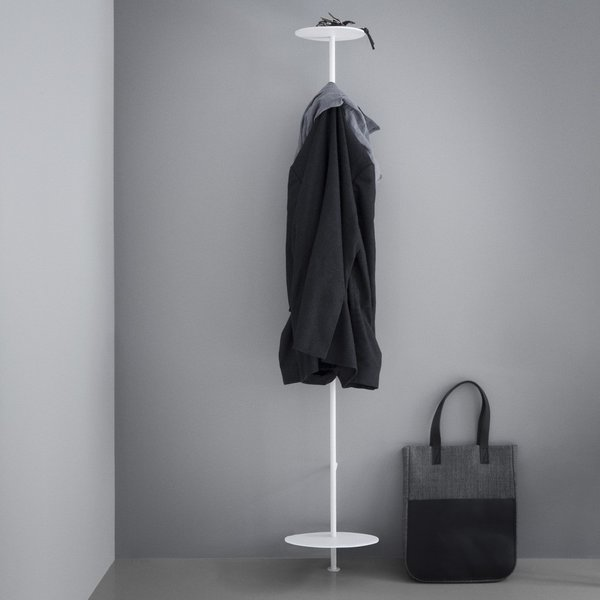 Designed with apartment-living and small spaces in mind, the Norm Coat Hanger is a sleek, powder-coated steel coat stand with a small footprint. The top platform can be used to hold a hat, keys, and sunglasses, while the lower platform can prop up a pair of shoes or a bag. Near the top of the stand, there is a hook for hanging jackets, which also extends back to the wall, giving an extra place for draping a scarf or hanging a coat from a hanger.