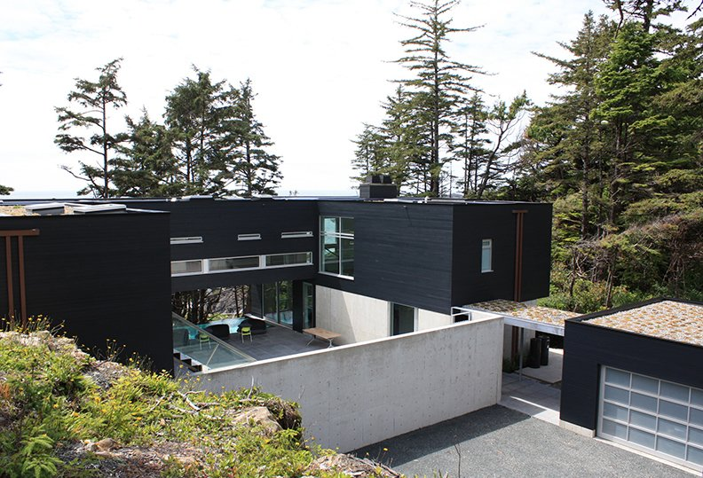 Exterior, Prefab Building Type, and House Building Type The main building sinks then elevates in full view of ocean.  Prefab from A Giant, 20-Module Prefab Perched Across a Coastal Site in British Columbia