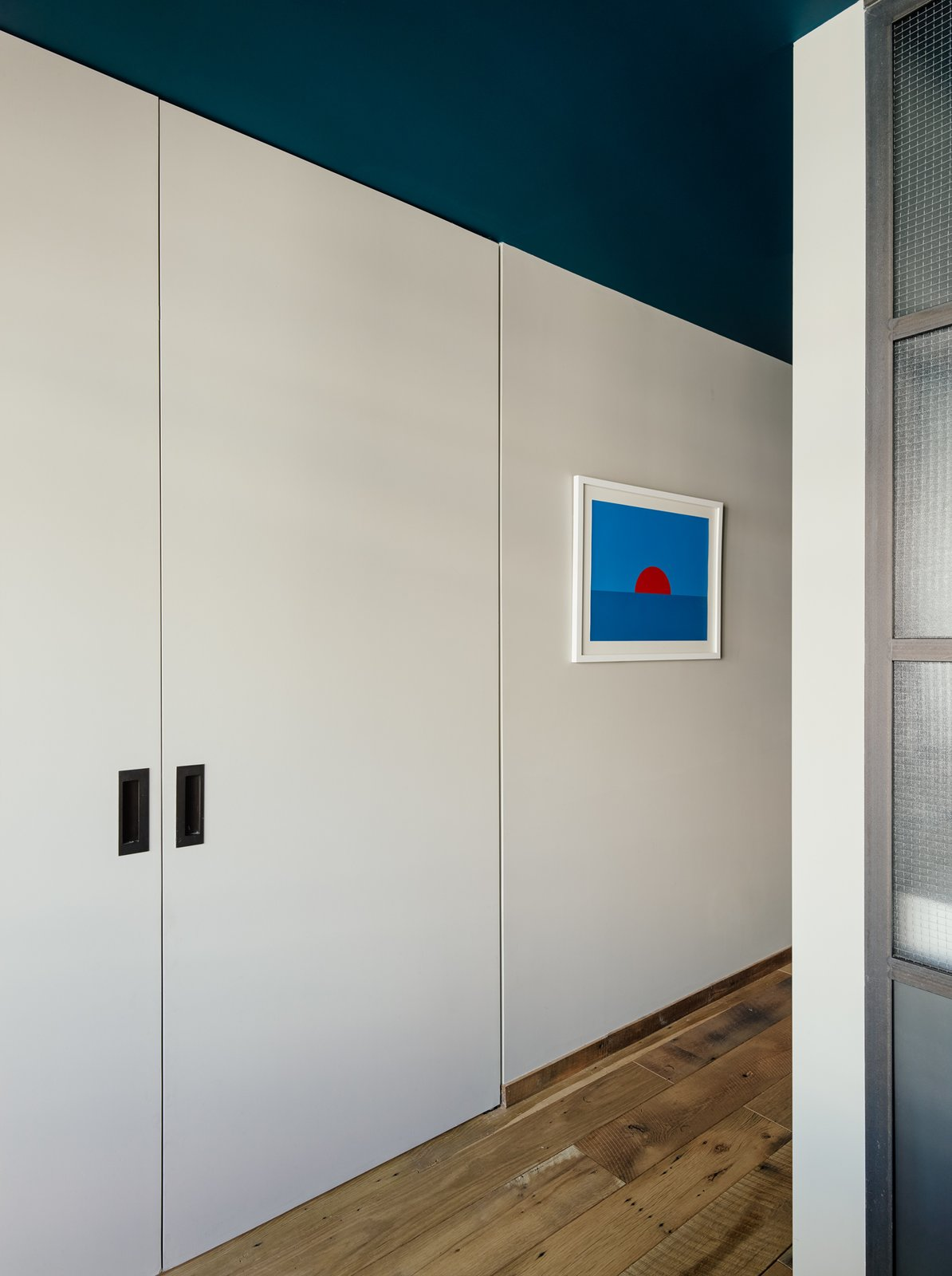 """The custom sliding doors are Zames's favorite detail in the home. """"They are functional, but also manage to balance nice clean modern details without being cold,"""" she says.  Photo 9 of 9 in Two Apartments Were Combined into This Inviting Brooklyn Home"""