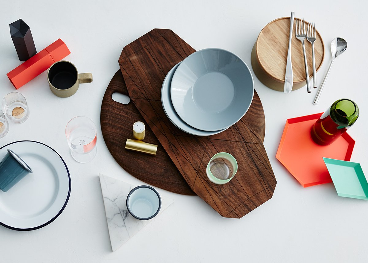 The Dwell Store's Gifts for the Cook Collection includes classic tabletop accessories and distinctive dishware.  Shown: Hasami Wood Tray $16–$125, Mu Flatware Setting $90, Hasami Porcelain Plate $6–$60, Teema Soup Bowl $24, Ray Long Board $90, Two Hole Vase $55, Kaleido Tray $16–$78, White Marble Trivet $88, Falcon Enamelware Tumbler $8, Hasami Porcelain Mug $16–$20, Ori Salt or Pepper Grinder $20.99. Available from the Dwell Store.  Photo 1 of 9 in Dwell Store Gift Guide: Gifts for the Cook