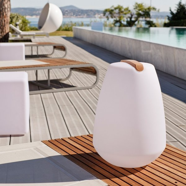 The Vessel Portable Outdoor LED Lamp - Pebble ($209) is easier to carry than you think: the small wooden detail at its top lifts up to become a handle. It's also shockproof, waterproof, rechargeable, and cordless.