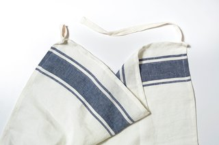 Chef's Towel from Snowe, $25 at snowehome.com  As handy for wiping up spills as tying around the waist as a half apron, this machine washable towel, spun from Belgian linen in Italy, will be a cook's best friend.