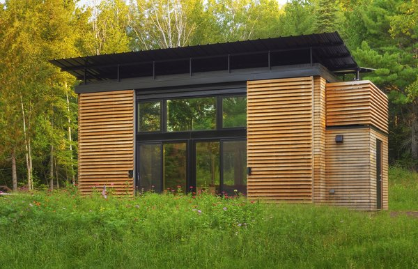 In September 2009, Bill and Daniel Yudchitz bought a 2.78-acre lot that had water access to Lake Superior's Chequamegon Bay. Many of the properties they looked at required a larger minimum building footprint than they desired; their cabin needed to be small to reduce its environmental impact.