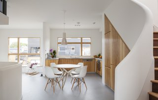 The kitchen countertop is polished concrete. The cupboards are clad in Marine plywood with an olive ash veneer.
