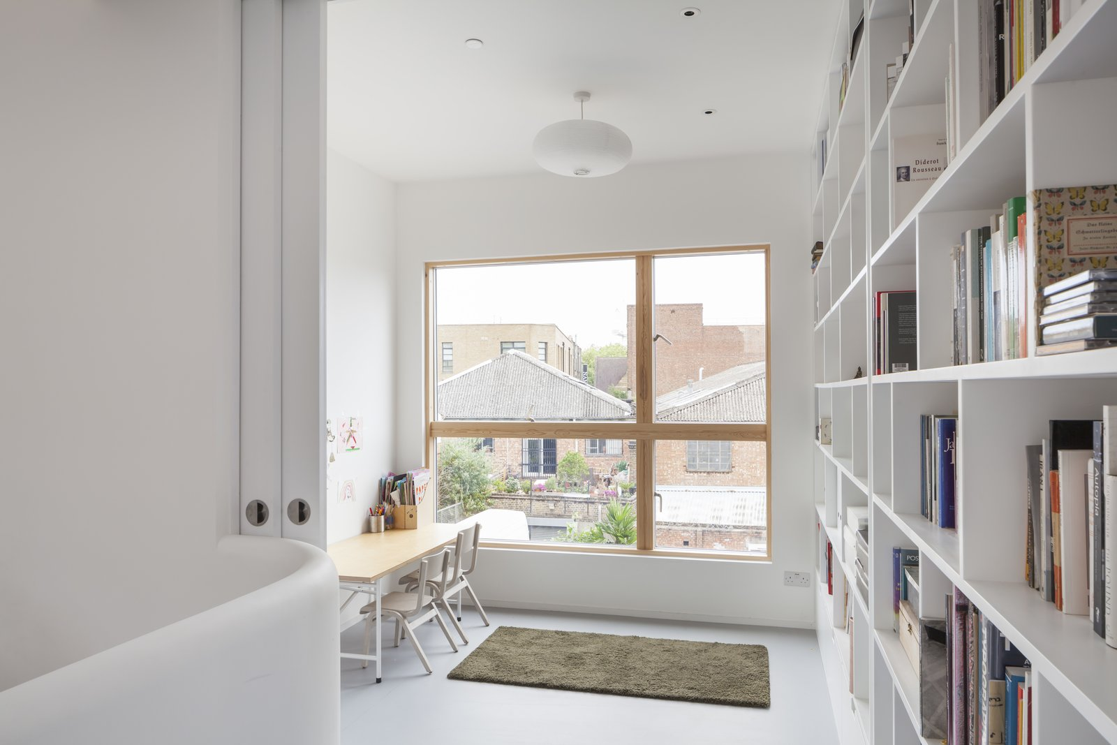 Office, Shelves, and Bookcase An office nook and library can participate in the open plan or disappear behind pocket doors.  Best Office Photos from A Clever Sunken Roof Fills a London Terrace House with Light