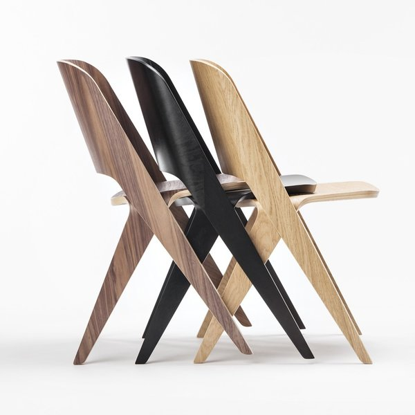 While it can't stack vertically, the Lavitta Molded Plywood Chair ($995-$1,030) can snugly fit together in rows. From Finnish brand Poiat, the chair comes in versions ranging from black stained birch to steamed walnut and more.