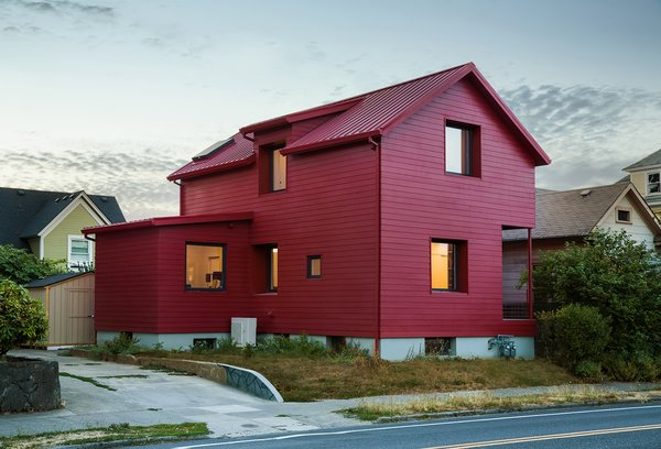 Waechter Architecture reimagined a traditional gabled home in southeast Portland without significantly altering the original building. A simple coat of red paint abstracts the century-old structure, creating a residential work of art.