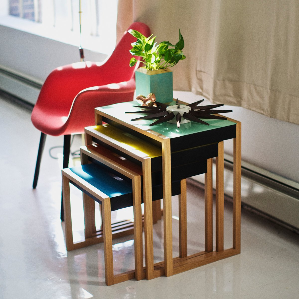 """A modern reproduction of a 1926 set of tables, these nesting tables show Josef Albers's mastery of color. The set was originally built for the Moellenhoff family in Berlin, Germany. Although their home was destroyed in the war, this piece, along with many others, was saved and brought to the United States prior to the outbreak of World War II.  Search """"classic danish nesting tables set"""" from Iconic Furniture Designs by Josef Albers"""