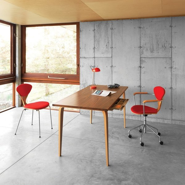From the The Cherner Chair Company comes these two equisitely-crafted pieces: the Cherner Studio Task Chair ($1049) and the Cherner Studio Desk ($1999 to $2229). In addition to a wide variety of woods, the chair comes in an armless version while the table comes in two different sizes (48 or 60 inches wide).