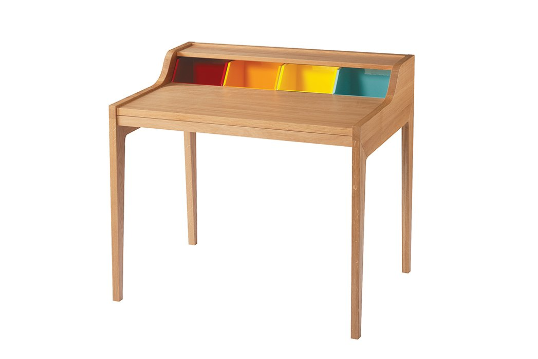 From the Remix line, an extendable oak desk based on the classic Davenport silhouette is updated with the addition of four colorful compartments.  Photo 6 of 14 in Modern Furniture Designer Continues Her Family Tradition