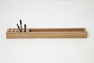 This simple desk organizer is carved out of solid oak.