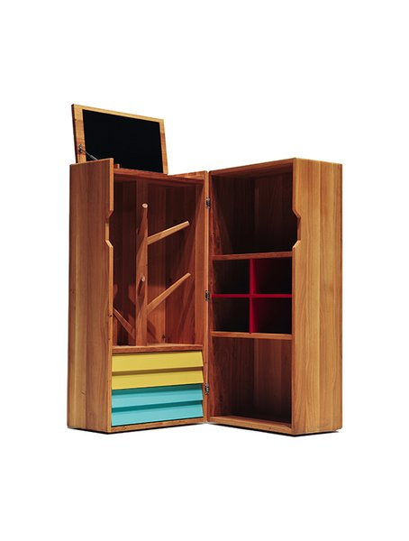 This wooden trunk may be nondescript on the outside, but inside it can hold a complete home bar.  Photo 13 of 14 in Modern Furniture Designer Continues Her Family Tradition