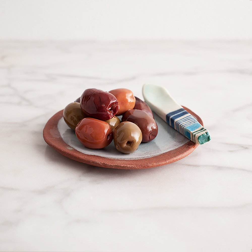 Olive Dish and Spoon by Carnevale Clay, $26 at carpenterhill.com  Having a dinner party? Made by hand in Denver, Colorado, this food-safe stoneware dish helps set the tone of the evening.  Editor's Picks: Festive Gifts for the Entertainer by Allie Weiss